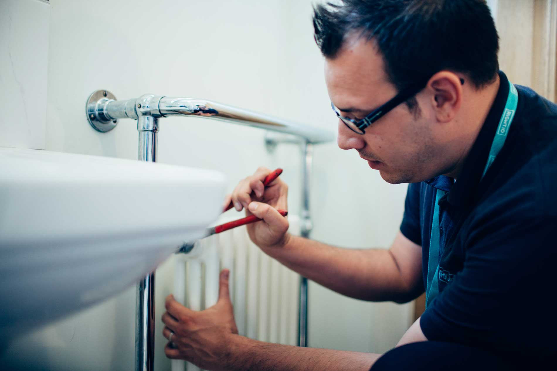 plumber fixing the bathroom plumbing in Birmingham