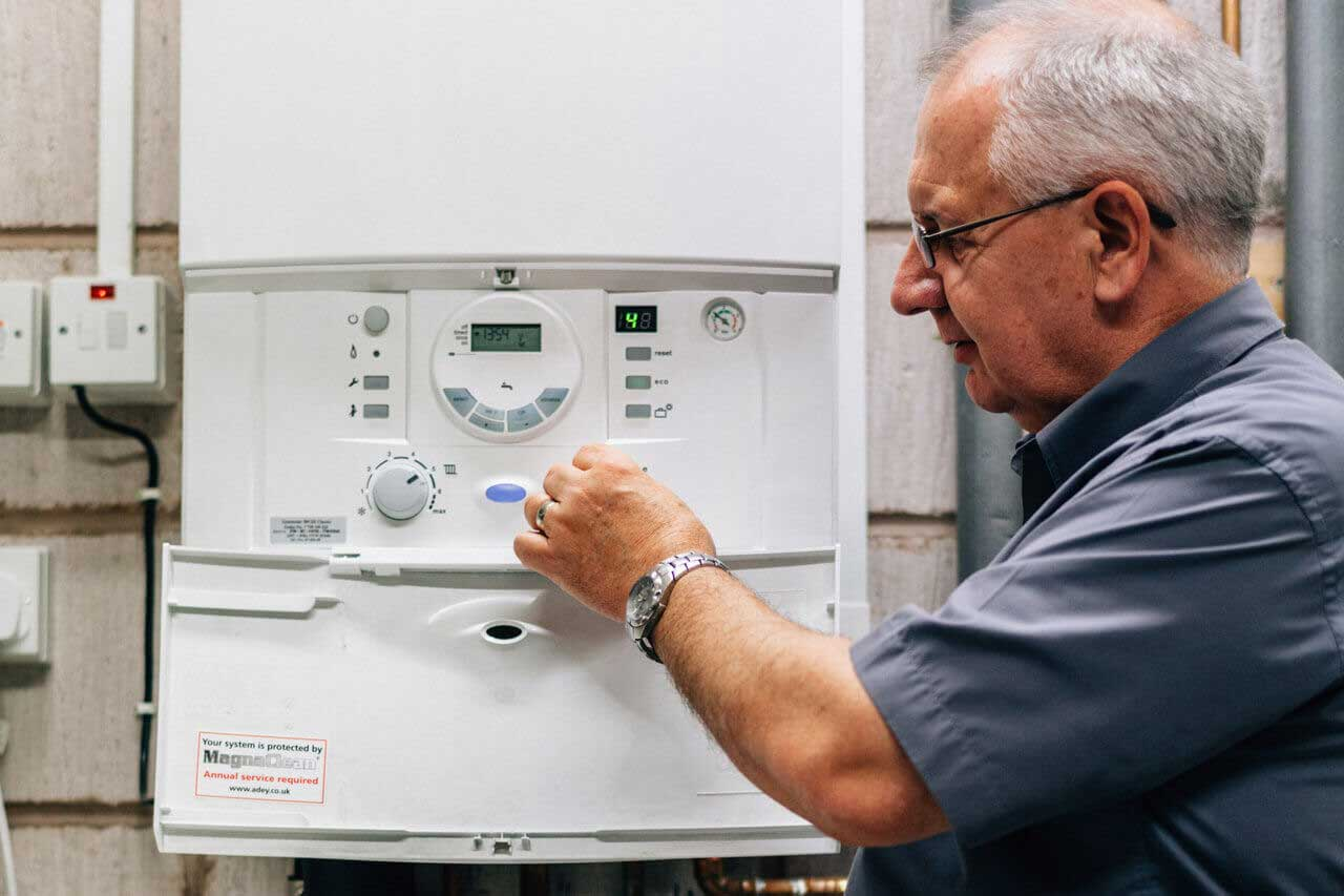 gas engineer fixing boiler