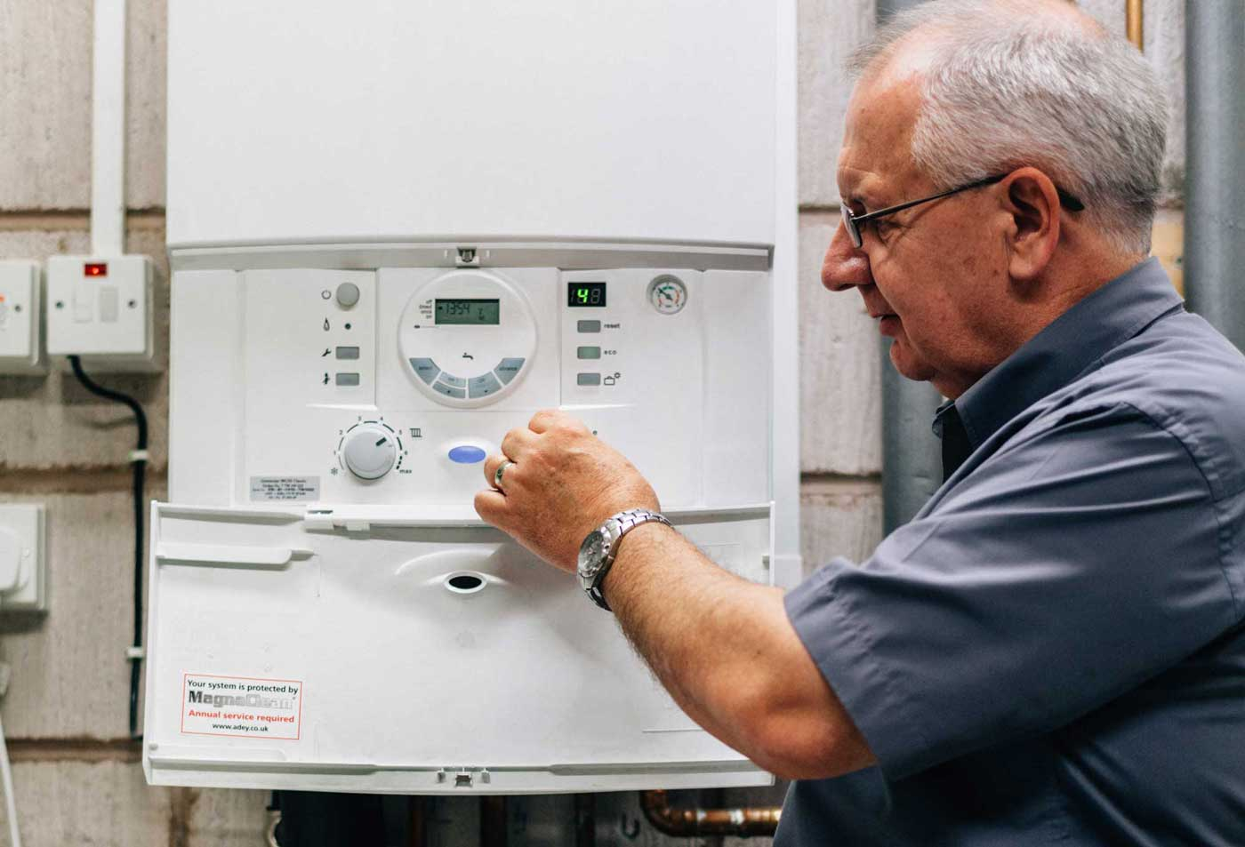 engineer performing a boiler service