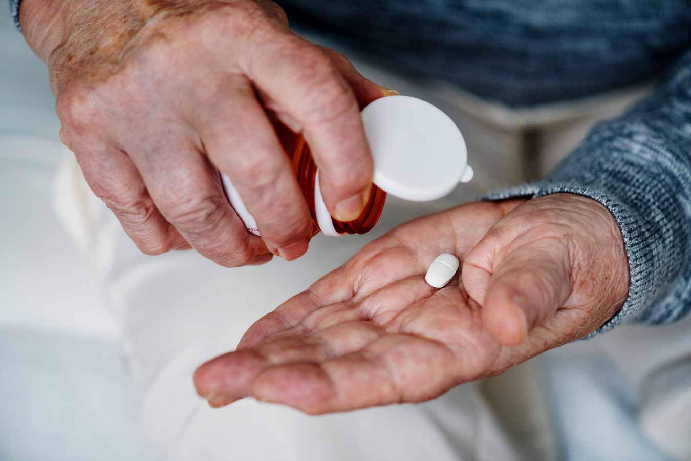 Old person taking medication